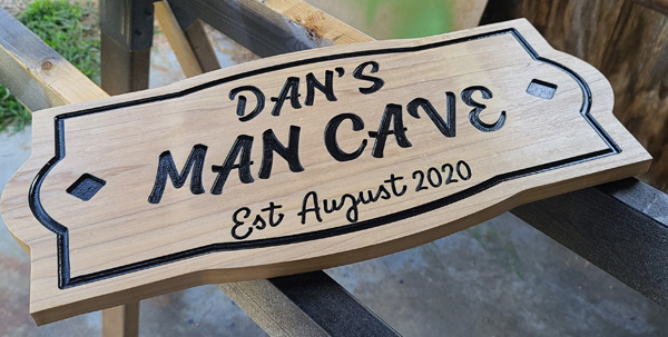 Engraved sign on Poplar, hand painted.
